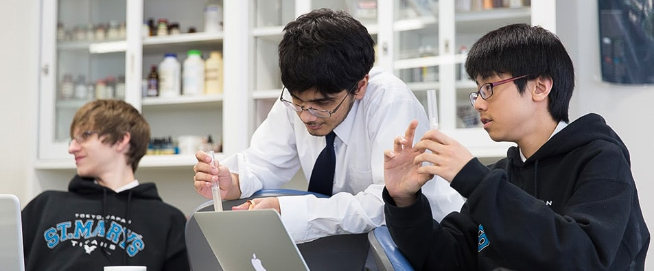 High School students working together in a science classroom