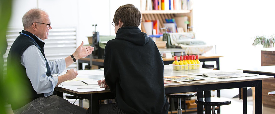 Teacher in one-on-one consultation with a student