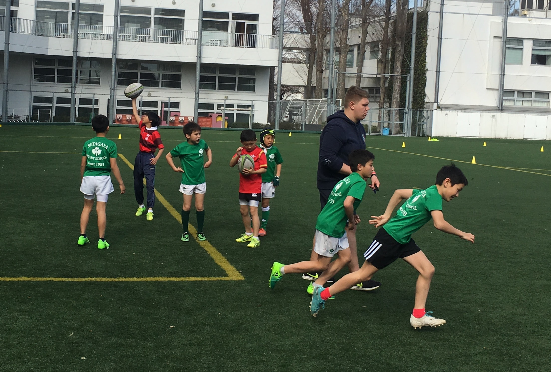 Elementary Boys Participating in a Rugby Clinic.