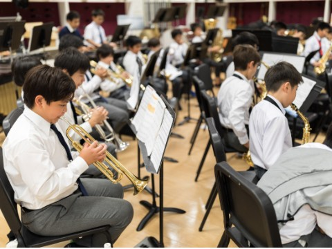 Students rehearsing in the band room