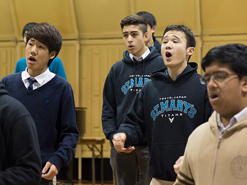 Students in St. Mary's hoodies in choir rehearsal